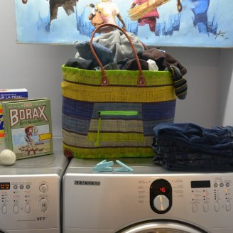 Unfolded laundry in a cheerful basket looks way nicer! ;-)