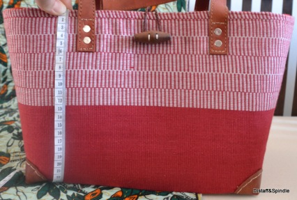 Tote: Red with upper red/white pattern. Wood toggle closure
