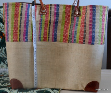 Vertial stripe basket. Size Medium. Cream with coloured stripes on upper.